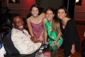 Ridge High students shared the dance floor with Matheny adult resident Yasin Reddick. From left, Emily Parker, Anna Hess and Sarah Desatnick.